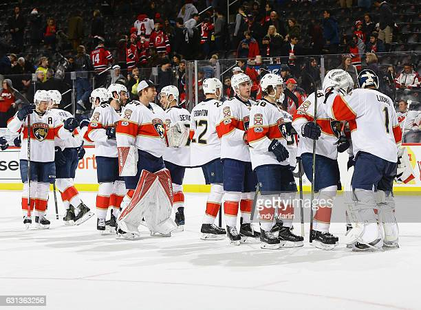 Roberto Luongo of the Florida Panthers celebrates with his teammates after defeating the New Jersey Devils at Prudential Center on January 9 2017 in...