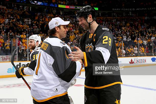 Roberto Luongo of the Florida Panthers greets John Scott of the Arizona Coyotes after the 2016 Honda NHL AllStar Final Game between the Eastern...