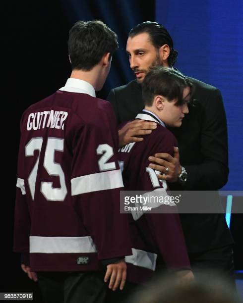 Roberto Luongo of the Florida Panthers greets Marjory Stoneman Douglas High School hockey team members Jesse Guttenberg and Justin Colton onstage...