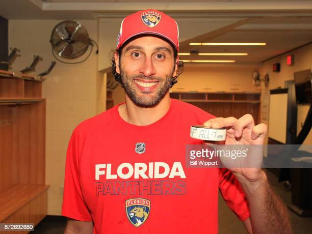 Roberto Luongo of the Florida Panthers holds the game puck after their 41 victory over the Buffalo Sabres and being 4th in alltime NHL goaltending...