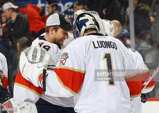 Roberto Luongo of the Florida Panthers is congratulated by James Reimer after defeating the New Jersey Devils at Prudential Center on January 9 2017...