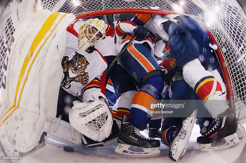 Roberto Luongo Of The Florida Panthers Is Pushed Aside As Players