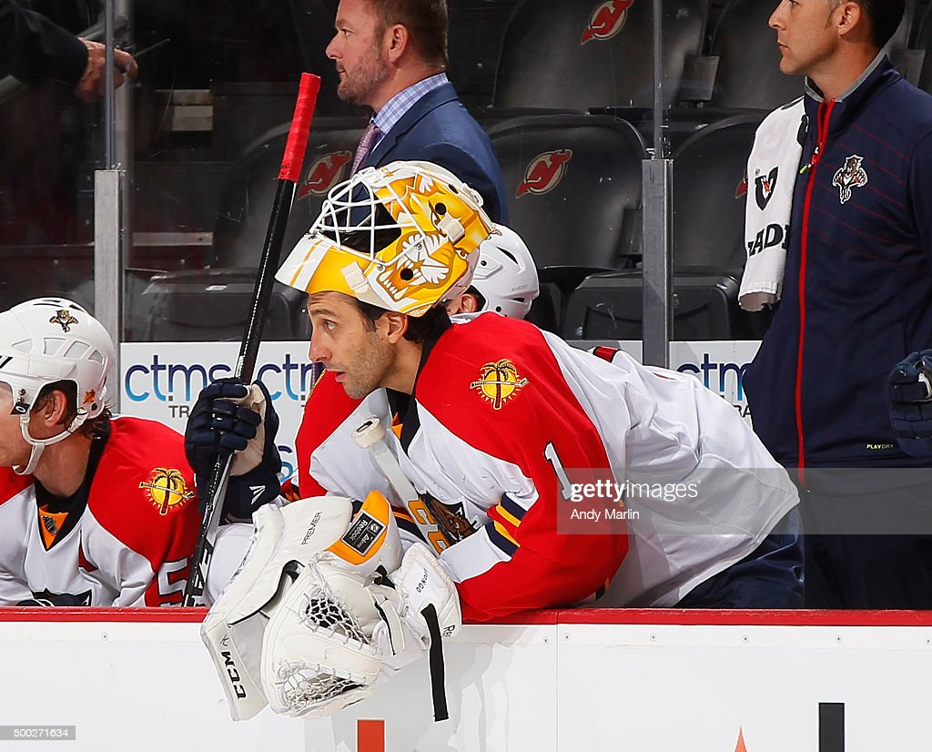 Roberto Luongo #1 of the Florida Panthers looks on from the bench after being replaced by extra skater late in the third period against the New Jersey Devils during the game at the Prudential Center on December 6, 2015 in Newark, New Jersey.