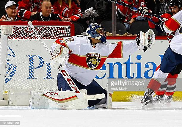 Roberto Luongo of the Florida Panthers makes a glove save against the New Jersey Devils during the game at Prudential Center on January 9 2017 in...