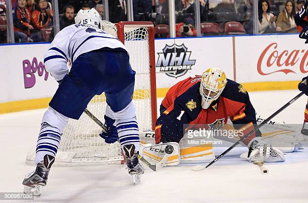 Roberto Luongo of the Florida Panthers makes a save against PA Parenteau of the Toronto Maple Leafs during a game at BBT Center on January 26 2016 in...