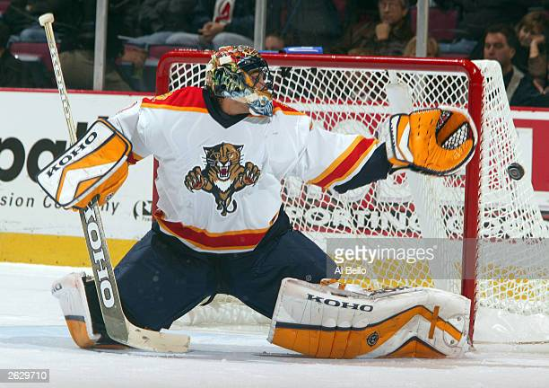 Roberto Luongo of the Florida Panthers makes a save against the New Jersey Devils October 22, 2003 at the Continental Airlines Arena in East...