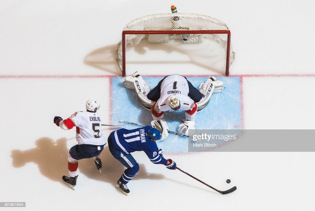 Roberto Luongo #1 of the Florida Panthers makes a save on Zach Hyman #11 of the Toronto Maple Leafs as Jonathan Huberdeau #11 of the Florida Panthers defends during the third period at the Air Canada Centre on February 20, 2018 in Toronto, Ontario, Canada.