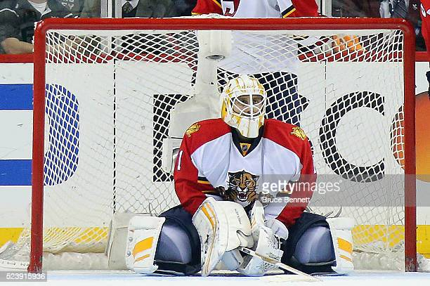 Roberto Luongo of the Florida Panthers pauses following giving up the winning goal to the New York Islanders in Game Six of the Eastern Conference...