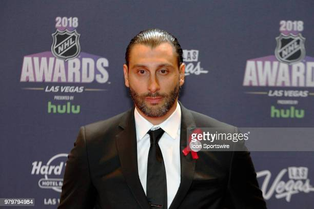 Roberto Luongo of the Florida Panthers poses for photos on the red carpet during the 2018 NHL Awards presented by Hulu at The Joint Hard Rock Hotel...