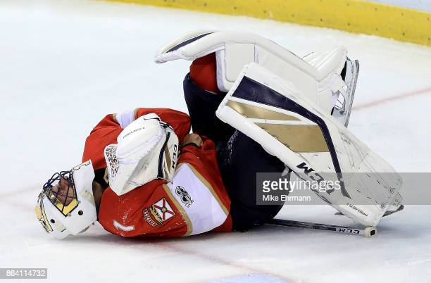 Roberto Luongo of the Florida Panthers reacts after injuring his hand during a game against the Pittsburgh Penguins at BBT Center on October 20 2017...