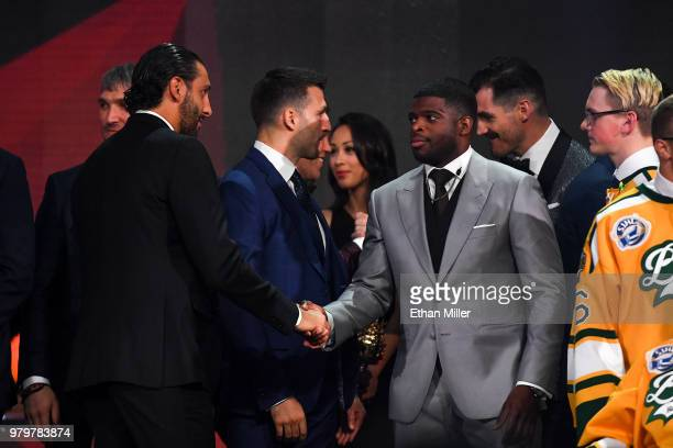 Roberto Luongo of the Florida Panthers shakes hands with PK Subban of the Nashville Predators onstage at the 2018 NHL Awards presented by Hulu at The...