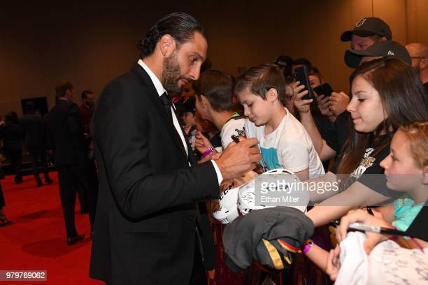 Roberto Luongo of the Florida Panthers signs autographs for fans as he arrives at the 2018 NHL Awards presented by Hulu at the Hard Rock Hotel Casino...