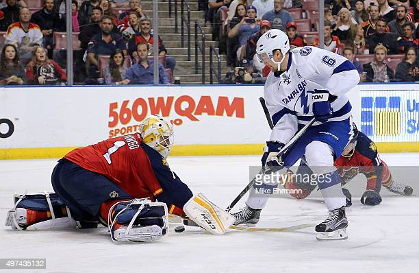 Roberto Luongo of the Florida Panthers stops a shot from Anton Stralman of the Tampa Bay Lightning during a game at BBT Center on November 16 2015 in...