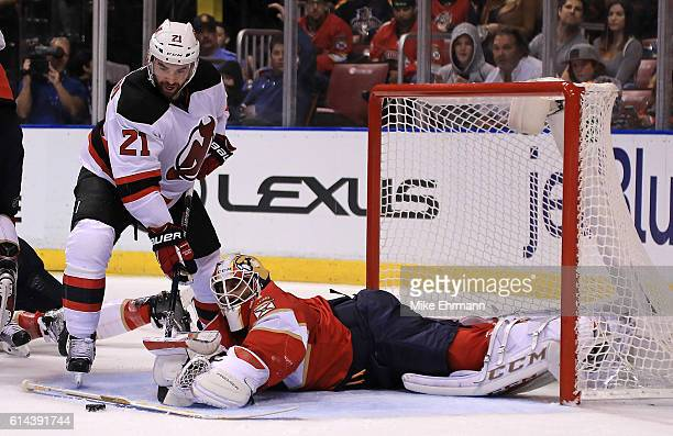 Roberto Luongo of the Florida Panthers stops a shot from Kyle Palmieri of the New Jersey Devils during Opening Night of the 20162017 NHL Season at...