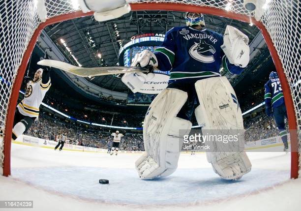 Roberto Luongo of the Vancouver Canucks 2reacts to a Boston Bruins goal during Game Seven of 2011 NHL Stanley Cup Final between the Boston Bruins and...
