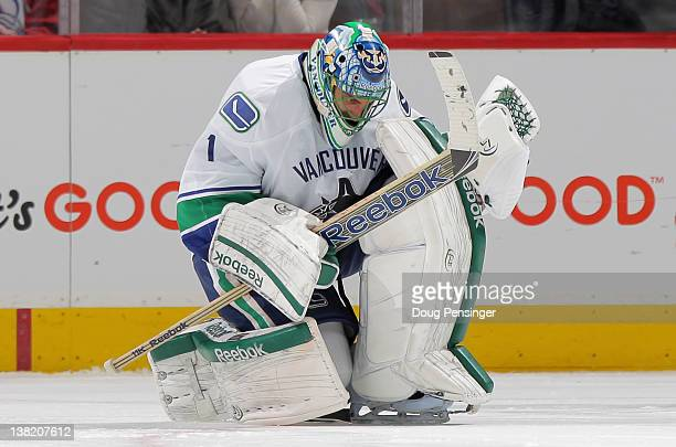 Roberto Luongo of the Vancouver Canucks celebrates after making the game winning save in a shoot out against Ryan O'Reilly of the Colorado Avalanche...