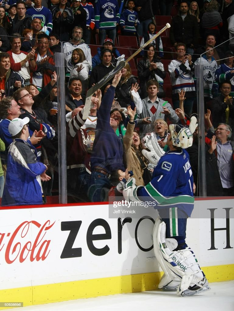Roberto Luongo Of The Vancouver Canucks Gives His Stick To A Young