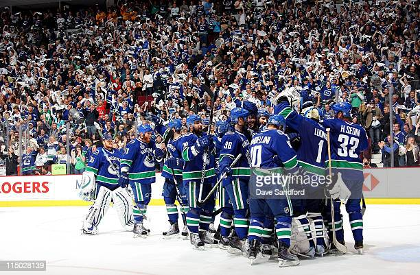 Roberto Luongo of the Vancouver Canucks is congratulated by teammates after he shut out the Boston Bruins 1-0 in game one of the 2011 NHL Stanley Cup...