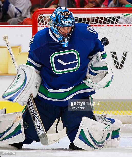 Roberto Luongo of the Vancouver Canucks juggles the puck making a save during their game against the Toronto Maple leafs at General Motors Place on...