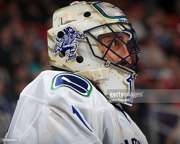 Roberto Luongo of the Vancouver Canucks looks down the ice during an NHL game against the Detroit Red Wings at Joe Louis Arena on March 3 2010 in...