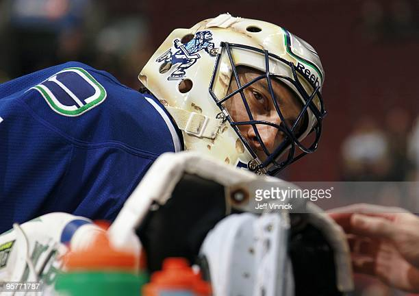 Roberto Luongo of the Vancouver Canucks looks gets his skate blade sharpened during their game against the Nashville Predators at General Motors...