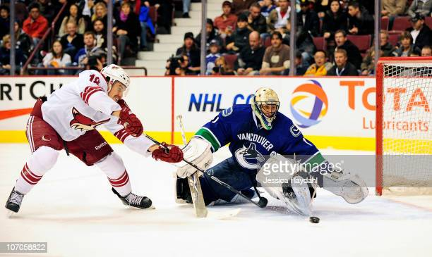 Roberto Luongo of the Vancouver Canucks looks makes a save off of Sami Lepisto of the Phoenix Coyotesat Rogers Arena on November 21, 2010 in...