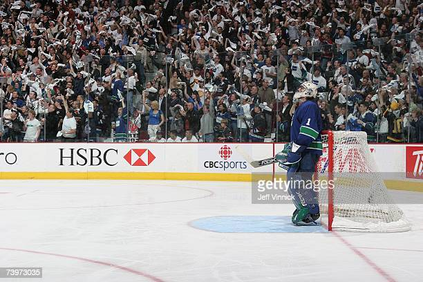 Roberto Luongo of the Vancouver Canucks looks on as fans wave towels during the game against the Dallas Stars during Game 7 of the 2007 Western...