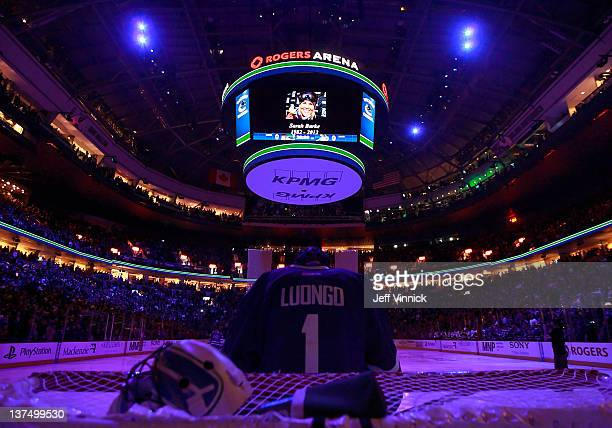 Roberto Luongo of the Vancouver Canucks looks on from his crease during a moment of silence for Canadian skier Sarah Burke who died recently after a...