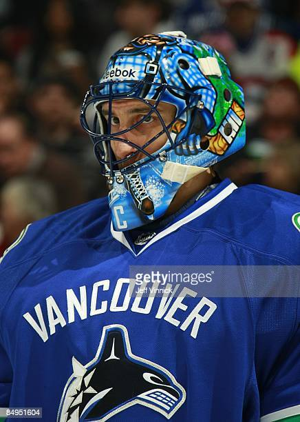 Roberto Luongo of the Vancouver Canucks looks on from his crease during their game against the Montreal Canadiens at General Motors Place on February...
