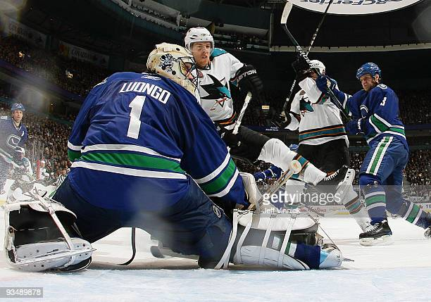 Roberto Luongo of the Vancouver Canucks makes a blocker save off a shot by Joe Pavelski of the San Jose Sharks during their game at General Motors...