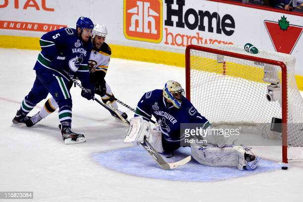 Roberto Luongo of the Vancouver Canucks makes a glove save against the Boston Bruins during Game Five of the 2011 NHL Stanley Cup Final at Rogers...