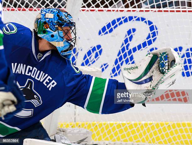 Roberto Luongo of the Vancouver Canucks makes a glove save during Game Two of the Western Conference Semifinal Round of the 2009 Stanley Cup Playoffs...