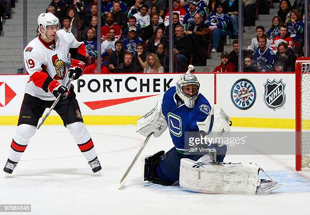 Roberto Luongo of the Vancouver Canucks makes a glove save off a shot by Jason Spezza of the Ottawa Senators during their game at General Motors...