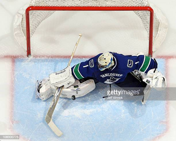 Roberto Luongo of the Vancouver Canucks makes a pad save during their game against the Dallas Stars at Rogers Arena on January 24, 2011 in Vancouver,...
