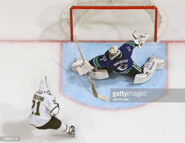 Roberto Luongo of the Vancouver Canucks makes a pad save off the shot of Loui Eriksson of the Dallas Stars during their game at Rogers Arena on...