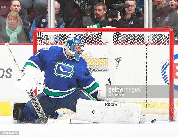 Roberto Luongo of the Vancouver Canucks makes a save against the Phoenix Coyotes during their NHL game at Rogers Arena on December 6, 2013 in...