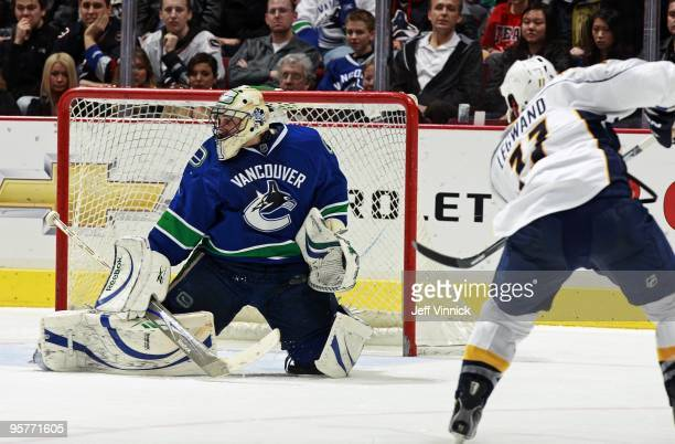 Roberto Luongo of the Vancouver Canucks makes a save off the shot of David Legwand of the Nashville Predators during their game at General Motors...