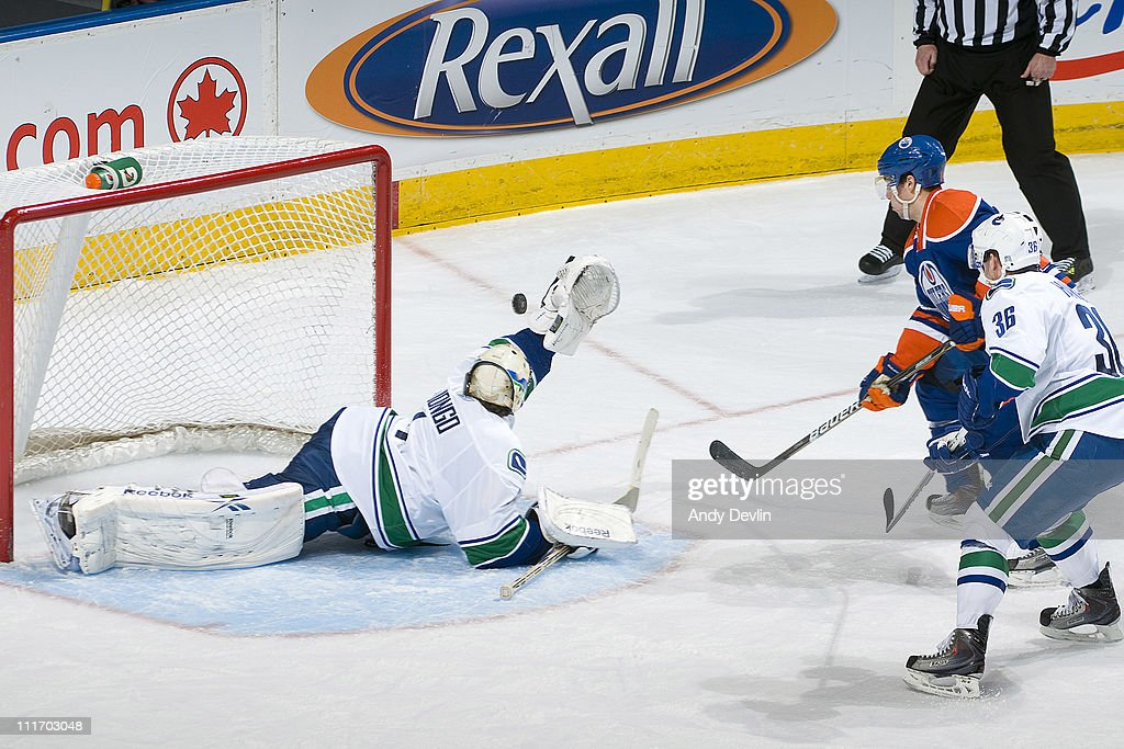 Roberto Luongo #1 of the Vancouver Canucks makes a sprawling save against Linus Omark #23 of the Edmonton Oilers at Rexall Place on April 5, 2011 in Edmonton, Alberta, Canada.