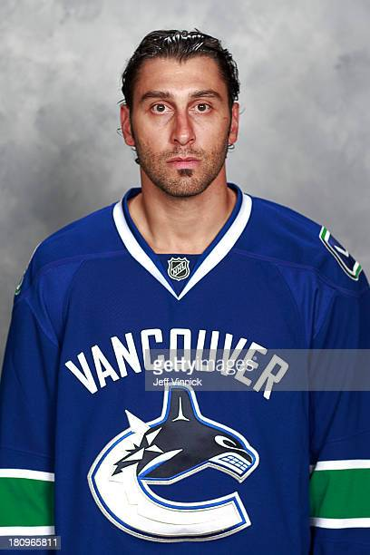 Roberto Luongo of the Vancouver Canucks poses for his official headshot for the 2013-14 NHL season on September 11, 2013 at Rogers Arena in...