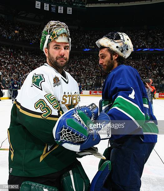 Roberto Luongo of the Vancouver Canucks shakes hands with Marty Turco of the Dallas Stars following Game 7 of the 2007 Western Conference...
