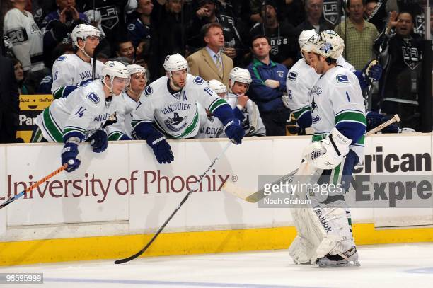 Roberto Luongo of the Vancouver Canucks skates to the bench after being pulled in the second period against the Los Angeles Kings in Game Three of...