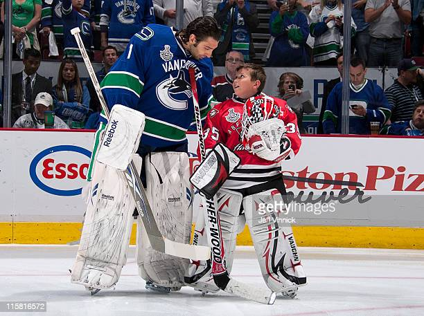 Roberto Luongo of the Vancouver Canucks talks with fellow goalie prior to Game Five of the 2011 NHL Stanley Cup Finals against the Boston Bruins at...