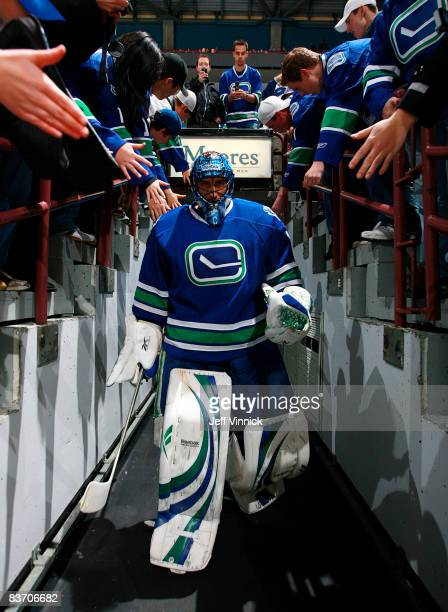 Roberto Luongo of the Vancouver Canucks walks out to the ice in the Canucks new third sweater during their game against the Toronto Maple leafs at...