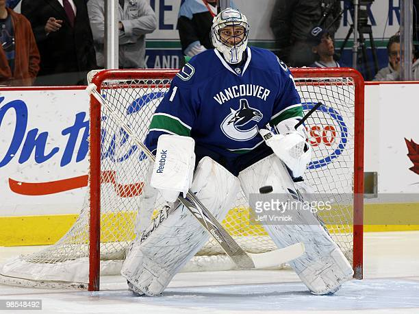 Roberto Luongo of the Vancouver Canucks watches a shot in Game One of the Western Conference Quarterfinals against the Los Angeles Kings during the...