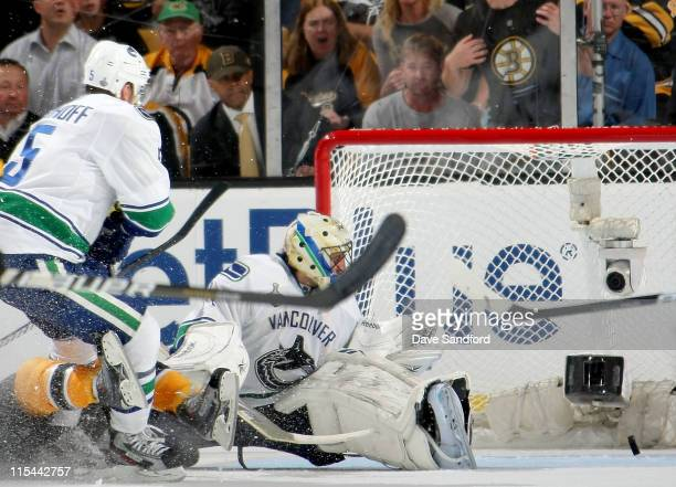 Roberto Luongo of the Vancouver Canucks watches the puck go in the net on a shot by Daniel Paille of the Boston Bruins who scored in the third period...