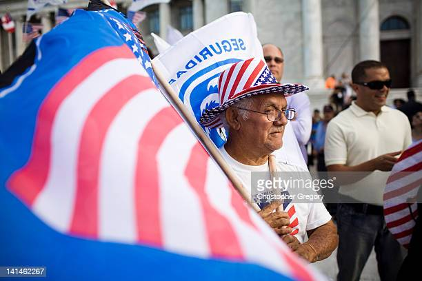 RICO MARCH Roberto Maldonado sells flags at a New Progressive Party rally where Republican presidential candidate former Massachusetts Gov Mitt...
