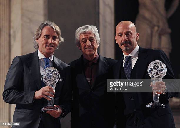 Roberto Mancini Gianni Rivera and Gianluca Vialli pose showing the awards during the Italian Football Federation Hall of Fame Award ceremony at...