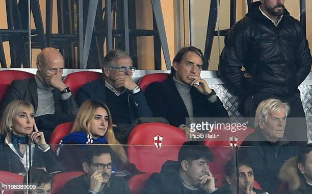 Roberto Mancini head coach of Italy and Attilio Lombardo watch in the stands during the Serie A match between UC Sampdoria and SSC Napoli at Stadio...