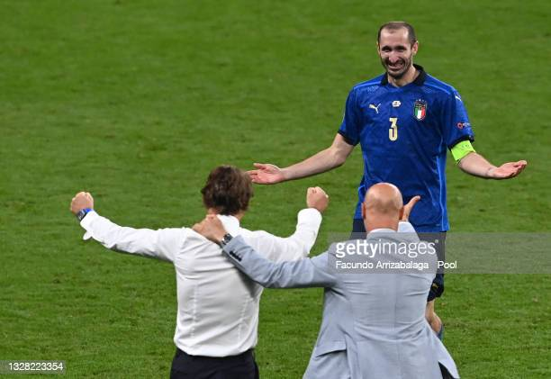 Roberto Mancini, Head Coach of Italy and Giorgio Chiellini of Italy celebrate following their team's victory in the UEFA Euro 2020 Championship Final...