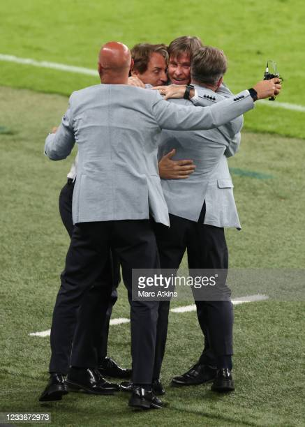 Roberto Mancini, head coach of Italy celebrates their 2nd goal with his coaching staff during the UEFA Euro 2020 Championship Round of 16 match...